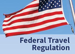 Federal Travel Regulation with United States flag flying above it against blue sky