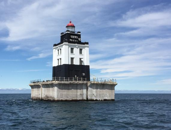 Long shot of Poe Reef Lighthouse in Lake Huron