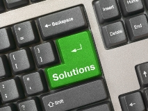 green keyboard key with the word solutions written on it